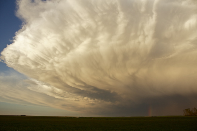 Ominous Storm Cloud with Rainbow Brooks, Alberta Canada