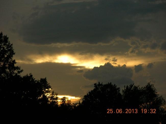 Sun playin peek a boo with dark clouds Salisbury, New Brunswick Canada