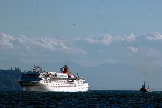 Cruiseship being escorted West Vancouver, British Columbia Canada