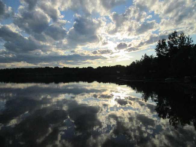 Setting sun at Lac Charette Moonbeam, Ontario Canada