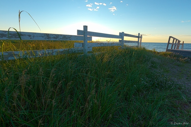 Fence and Sea Cap-Pele, New Brunswick Canada