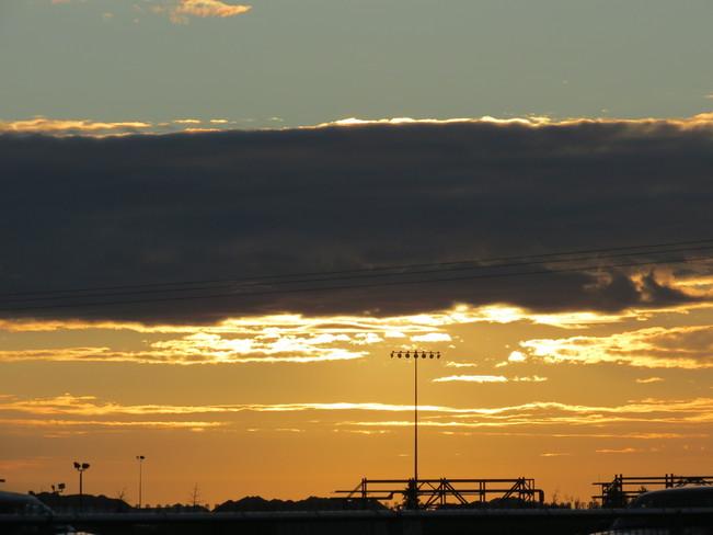 sun behind the cloud Edmonton, Alberta Canada