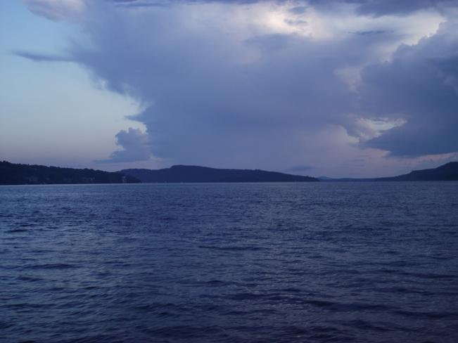 storm crossing river Quispamsis, New Brunswick Canada