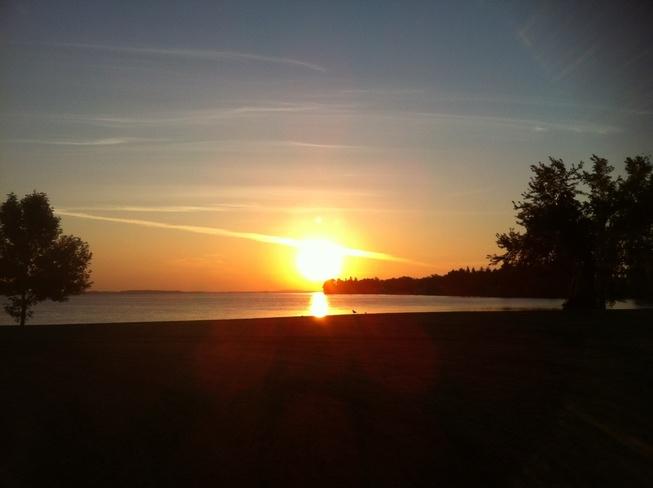sun rise on rainylake Fort Frances, Ontario Canada