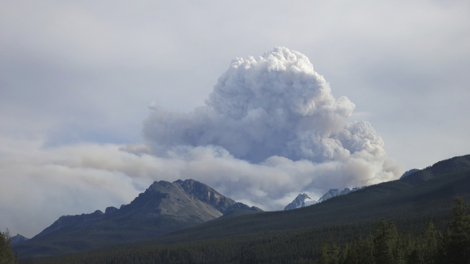 Smoke billows over mountain. Pic 1 Lake Louise, Alberta Canada