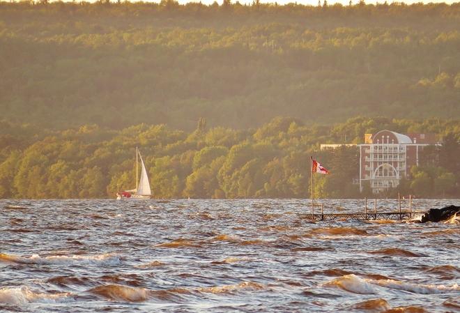 Sailing on a very windy Lake Nipissing at sunset. North Bay, Ontario Canada
