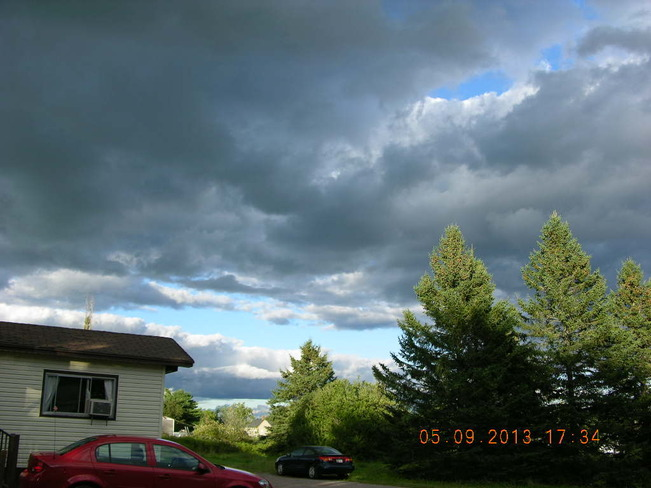Dark clouds trying to take over the skies Salisbury, New Brunswick Canada
