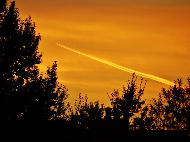 Jet after the sun set Edmonton, Alberta Canada