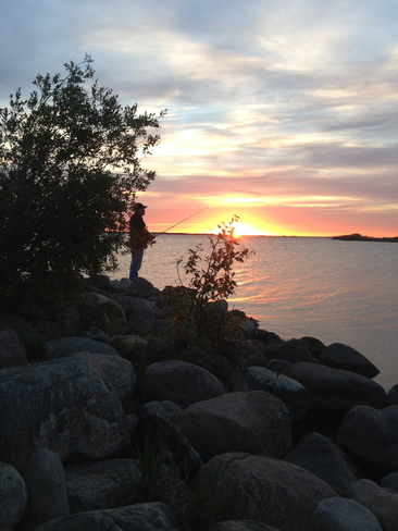 Fishing at sundown Elbow, Saskatchewan Canada