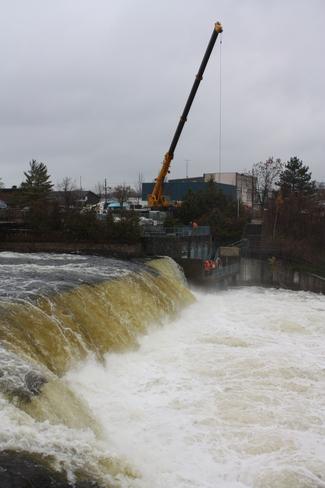 Men at work at the Falls Fenelon Falls, Ontario Canada