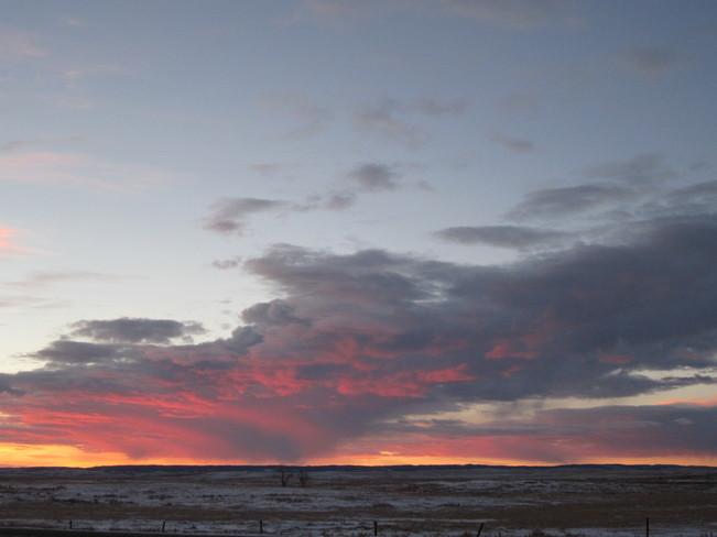 colorful sunrise over the hills Maple Creek, Saskatchewan Canada
