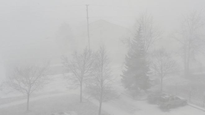 Snow Squalls. Hard to see across road. Orillia, Ontario Canada