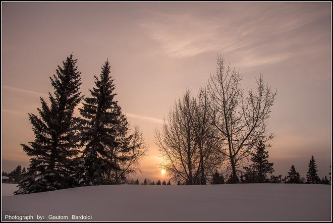 Beautiful Sunrise through thick clouds Edmonton, Alberta Canada