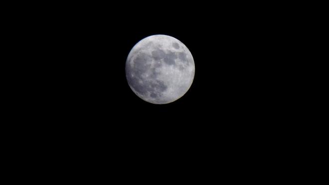 Full moon over Elliot Lake on a frigid night. Elliot Lake, Ontario Canada