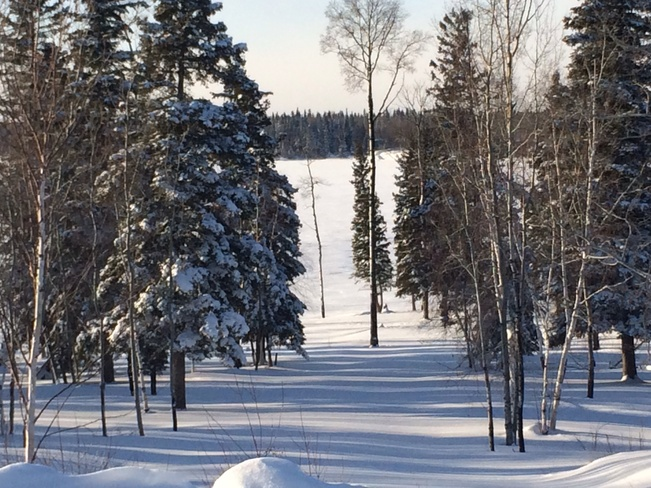 snow trail Cross Lake, Manitoba Canada