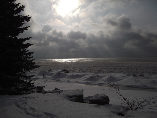 Sunbursts Over Lake Selkirk, Ontario Canada