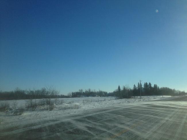 blowing snow on hiway 16 Minnedosa, Manitoba Canada