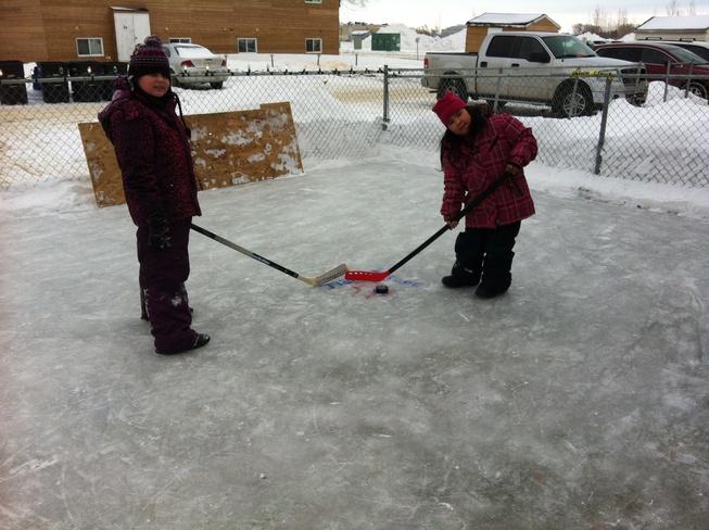 posing on cleared ice! Brandon, Manitoba Canada