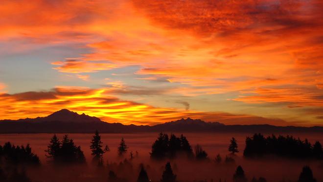 Sunrise over foggy White Rock White Rock, British Columbia Canada