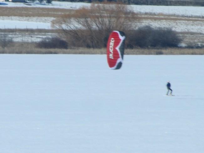 Wind snowboarding on swan lake Vernon, British Columbia Canada