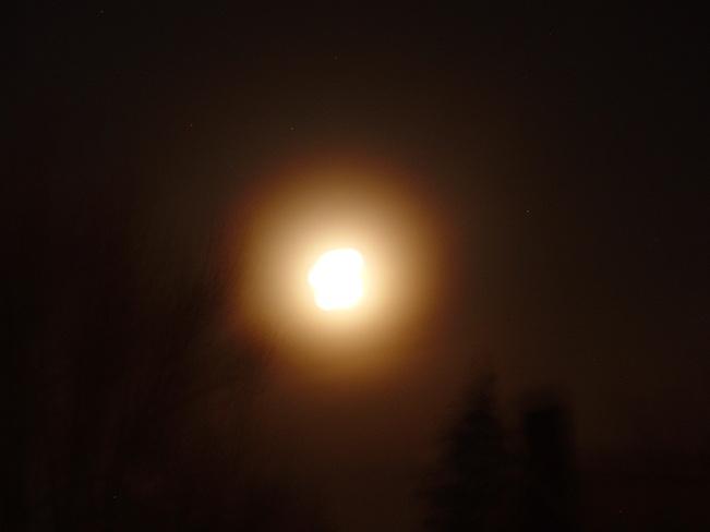 Gold fog around the moon. Kitchener, Ontario Canada