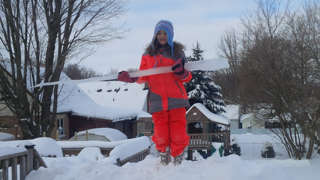 Girl holding huge icicle Kitchener, Ontario Canada