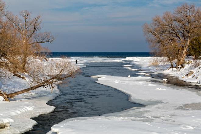 Winter fishing on the Beaver River Thornbury, Ontario Canada