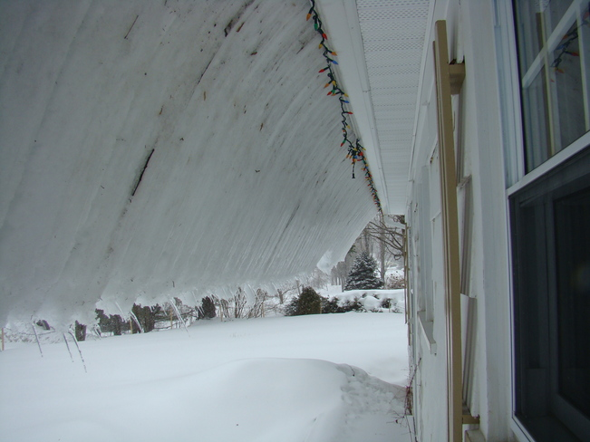 Snow of the roof Bathurst, New Brunswick Canada