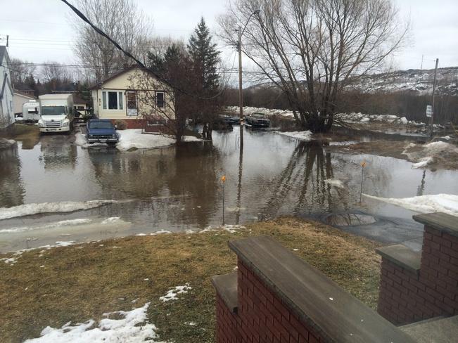 flooded streets Sudbury, Ontario Canada