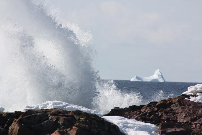 Iceburg and breaking waves Bonavista, Newfoundland and Labrador Canada