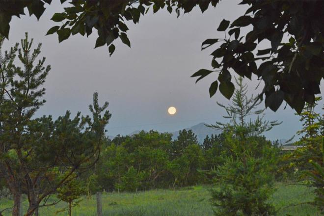 Moon Setting Over the Mountain Alberta Beach, Alberta Canada