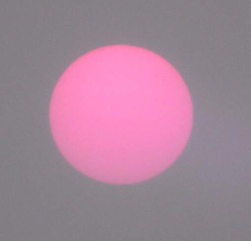 sun rise through smoke Cooks Mills, ON