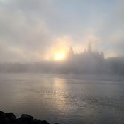 sun rising on a foggy morning