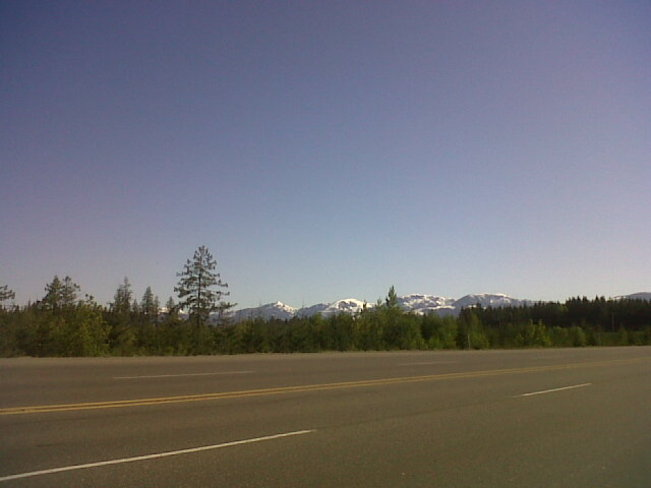 Blue sky, mountains and road. Courtenay, British Columbia Canada