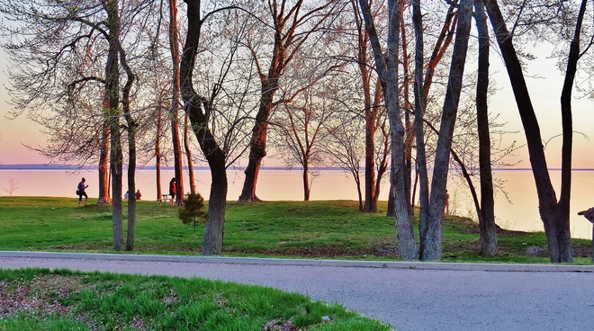 Locals gathering in Eva Wardlaw Park for tonight's sunset. North Bay, Ontario Canada