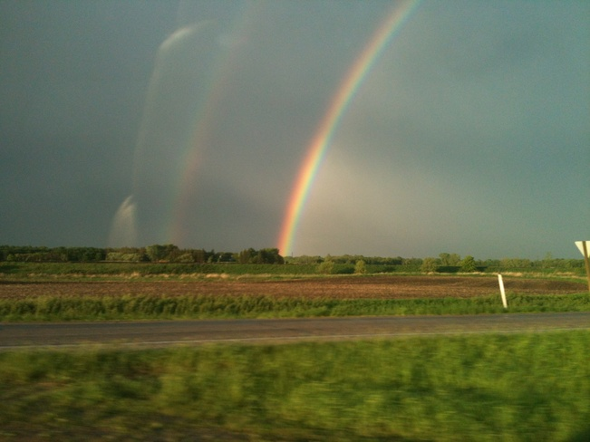 bright rainbow after the storm Morris, Manitoba Canada