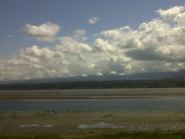 Low tide and variable sky. Courtenay, British Columbia Canada