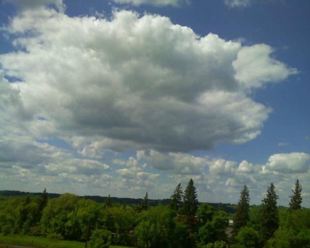 Fluffy clouds off my Balcony Brandon, Manitoba Canada