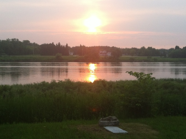 sunset on the red river Lockport, Manitoba Canada