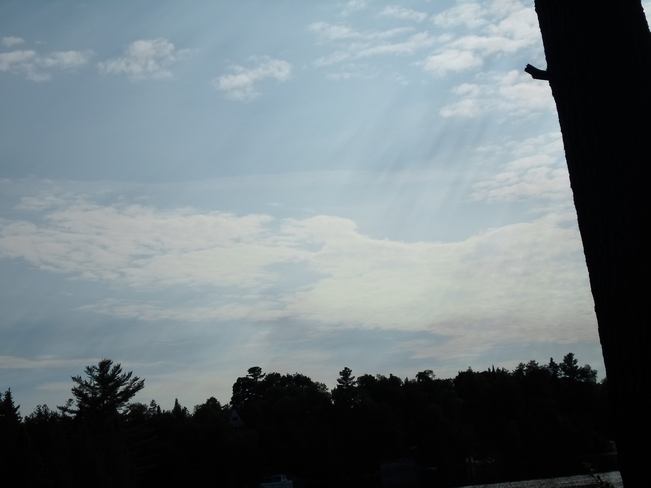 Clouds with ray's of moist air going up into them Elliot Lake, Ontario Canada