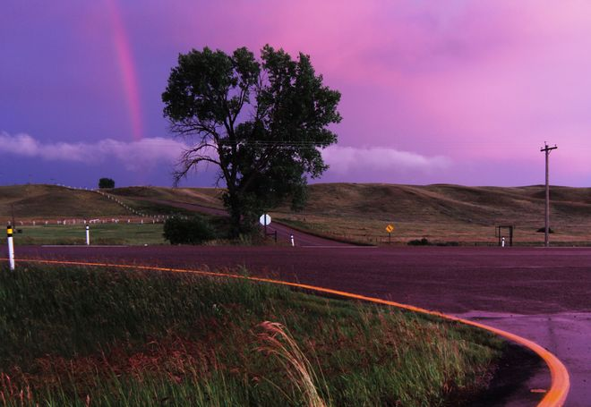 sunset rainbow Brooks, Alberta Canada