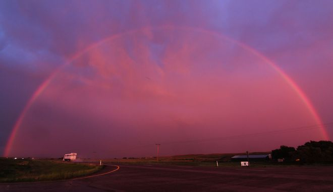 late evening full rainbow Brooks, Alberta Canada
