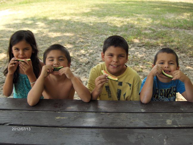 Grand Kids Enjoing Watermelon @ The Sauble Beach Massey On Massey, Ontario Canada
