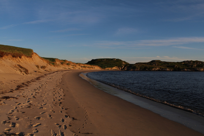 Warmth from the sunset on Sandbanks Beach Burgeo, Newfoundland and Labrador Canada