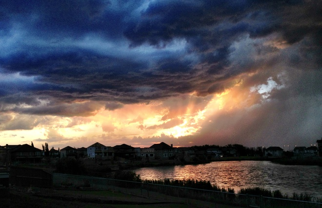 Sunset with storm clouds above Lakeland Village, Alberta Canada