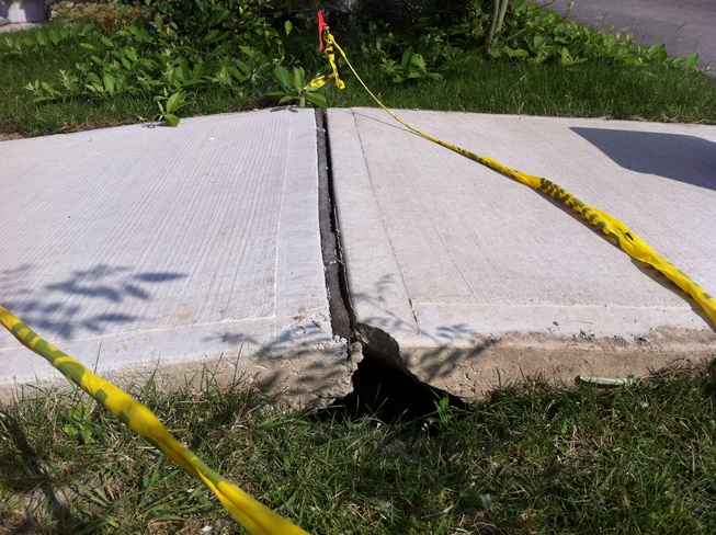 It was so hot that the 3 year-old sidewalk lifted off the ground. Milton, Ontario Canada