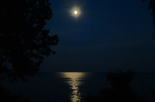 Moon and beam over the Lake Port Dover, Ontario Canada