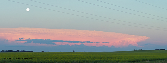 Full Moon rises above Tornadic thunderstorm in ND seen from Manitoba Brandon, Manitoba Canada