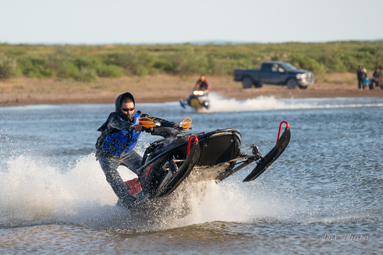 Snowmobiles Skipping Water 112