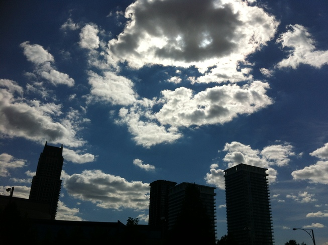 blue sky with clouds,flowers and more Mississauga, Ontario Canada